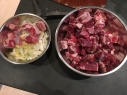 Chopped meat, bones, onions and garlic